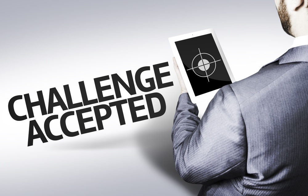 Business man with the text Challenge Accepted in a concept image